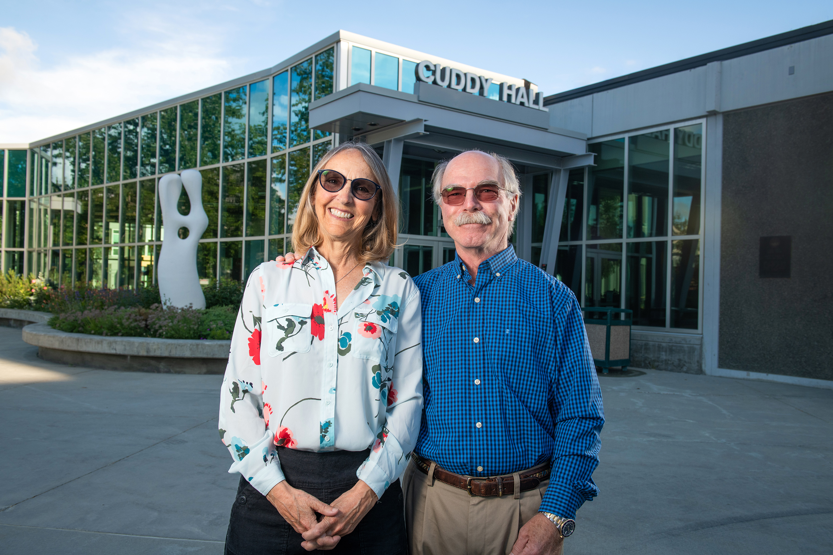Gary Klopfer, '81, and Jane Cuddy Klopfer in front of Cuddy Hall on the UAA campus.The building is named to honor Jane's grandmother, Lucy Hon Cuddy.