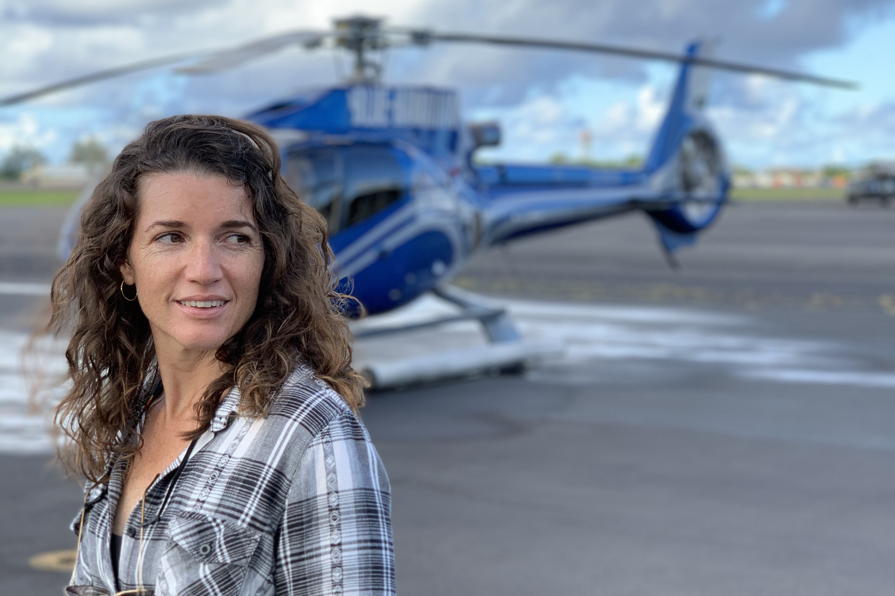 Sarah Snell standing in front of a chopper