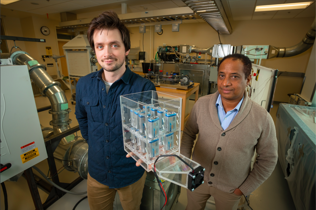 Getu Hailu, Ph.D., assistant professor of mechanical engineering at the UAA College of Engineering, and Martin Henke, a student in the mechanical engineering master's degree program, are working together to determine a simple and efficient way of keeping the batteries cool. (Photo by James Evans, University of Alaska Anchorage)