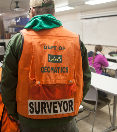 Geomatics labs take place all over campus, both in the classroom and out. It's a big reason why the field appeals to so many outdoorsy students. (Photo by Philip Hall / University of Alaska Anchorage)