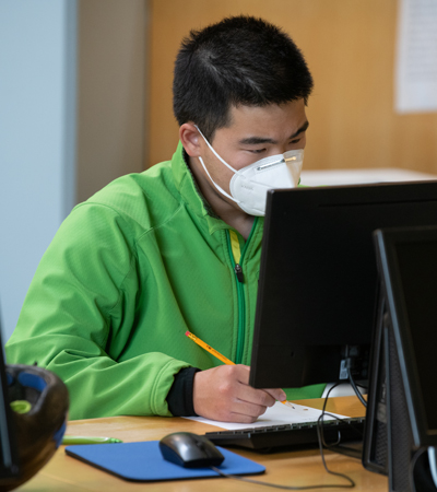 Stephen Yi studies in UAA's Consortium Library, which has remained open to students and researchers during the COVID-19 pandemic. (Photo by James Evans / UAA)