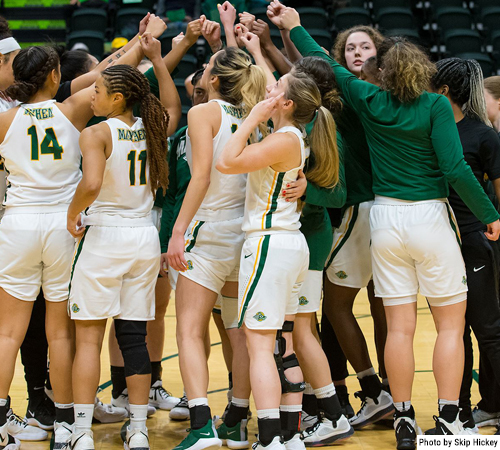 UAA women's basketball team celebrates 2020 GNAC victory with group huddle