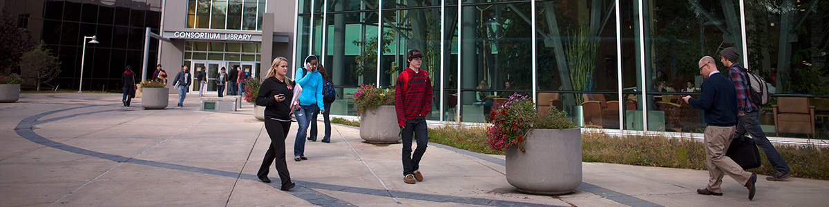 UAA Students walking outside Consortium Library