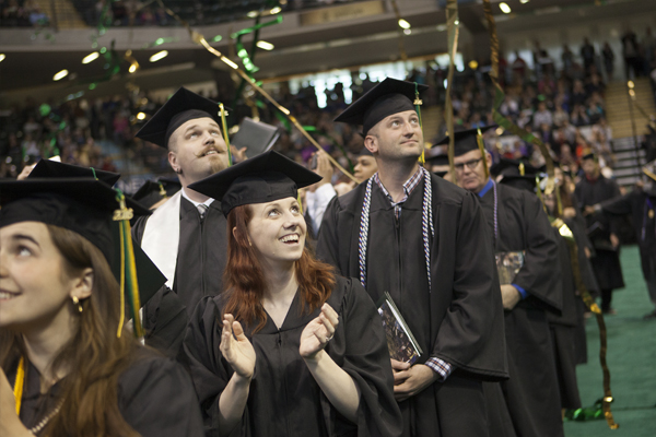 UAA graduates celebrate at the commencement ceremony.