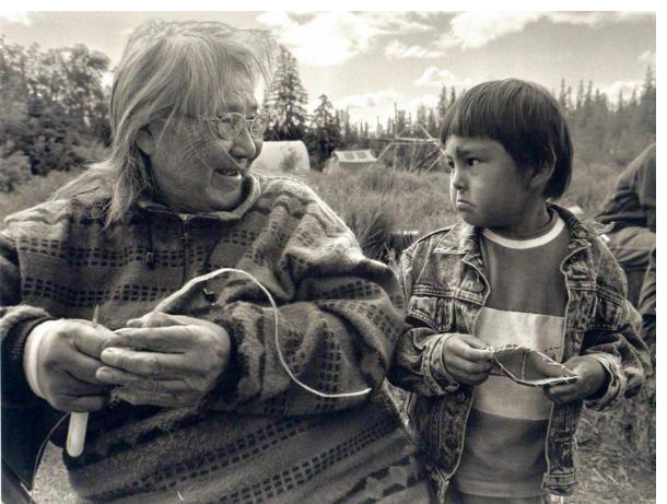 Katie John is seen here with her grandson Molly Galbreath at Batzulnetas fish camp.