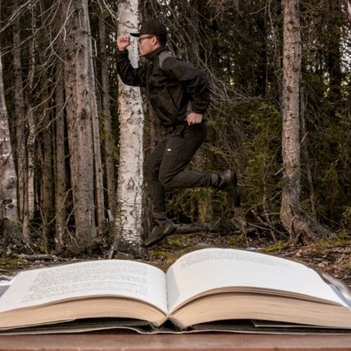 man jumping out of book