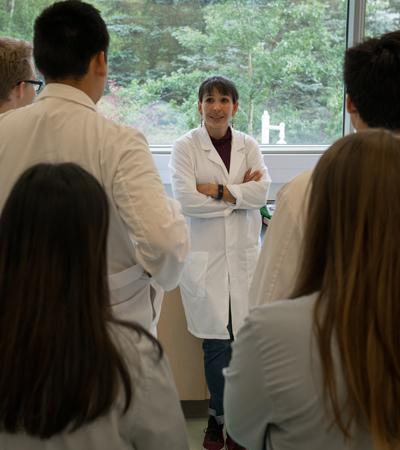 Kathryn Milligan-Myhre, assistant professor of biological sciences, leads a micro and genetics lab for students in the Della Keats Health Sciences Summer Program earlier this summer.