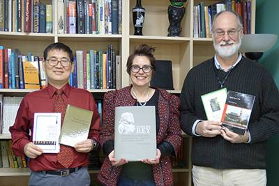 History faculty holding their respective publications