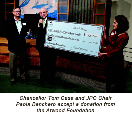 Chacellor Tom Case and JPC Chair Paola Banchero accept a donation from the Atwood Foundation.