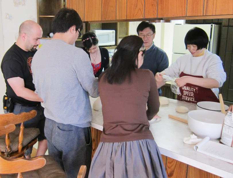 UAA Chinese students working with dough