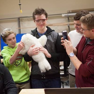 Students at Dimond High School meet Paro the robot seal