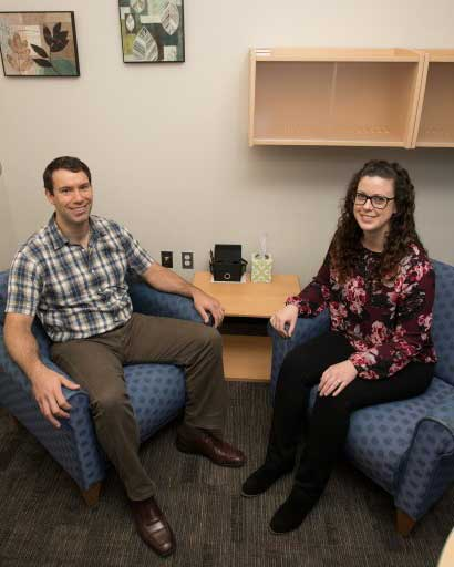 Dr. Grant Sasse, director of UAA's Psychological Services Center, and clinical psychology master's student Amber Frasure, photographed in one of the therapy rooms in the PSC.