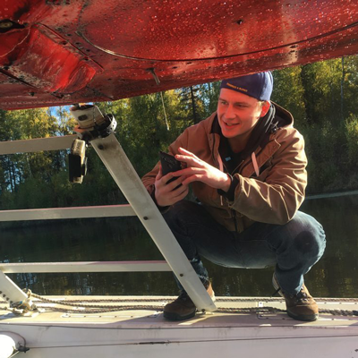 UAA Honors student Devin Boyle working on Elodea floatplane project
