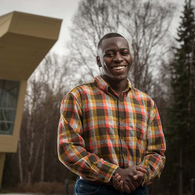 Civil Engineering graduate, Mohamed Niagne (Photo by James Evans / University of Alaska Anchorage)