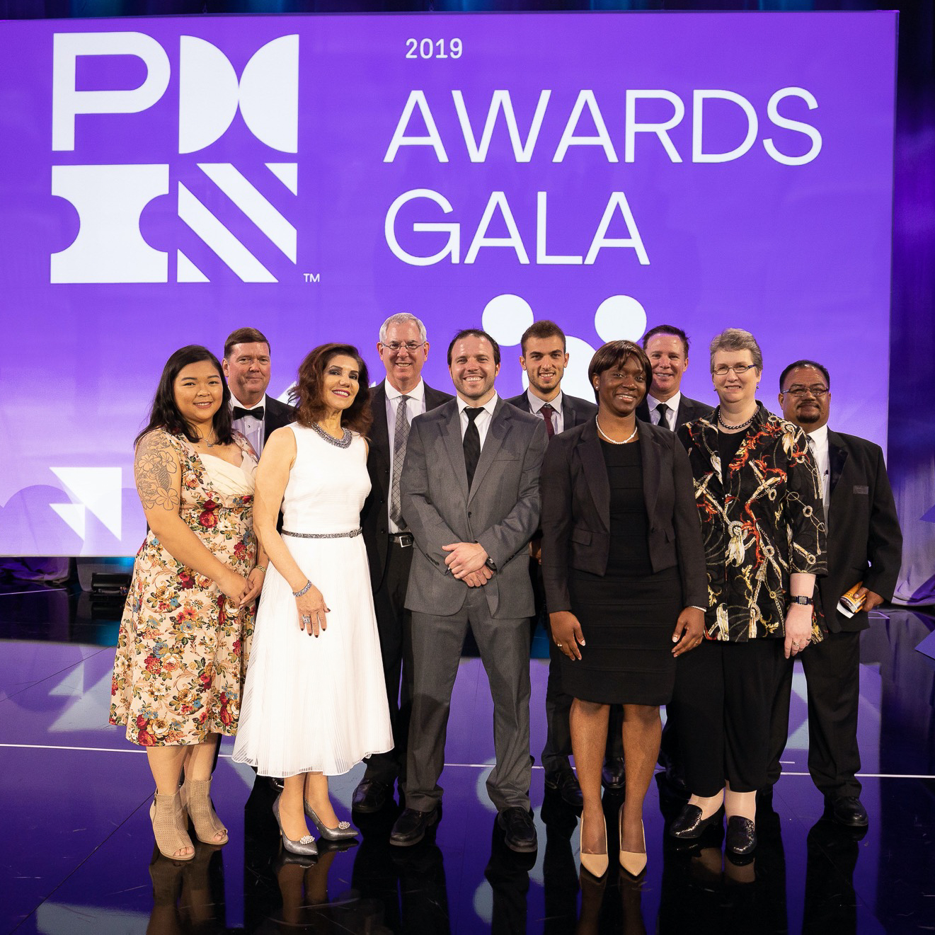 PMI award recipients on stage at gala event