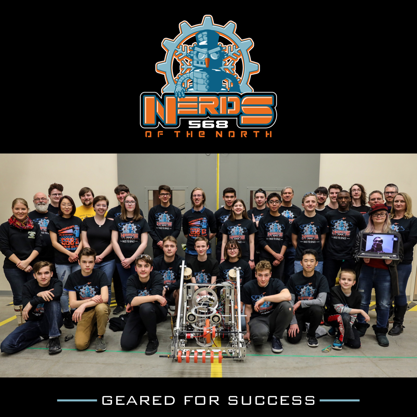 group photo of robotics team with robot