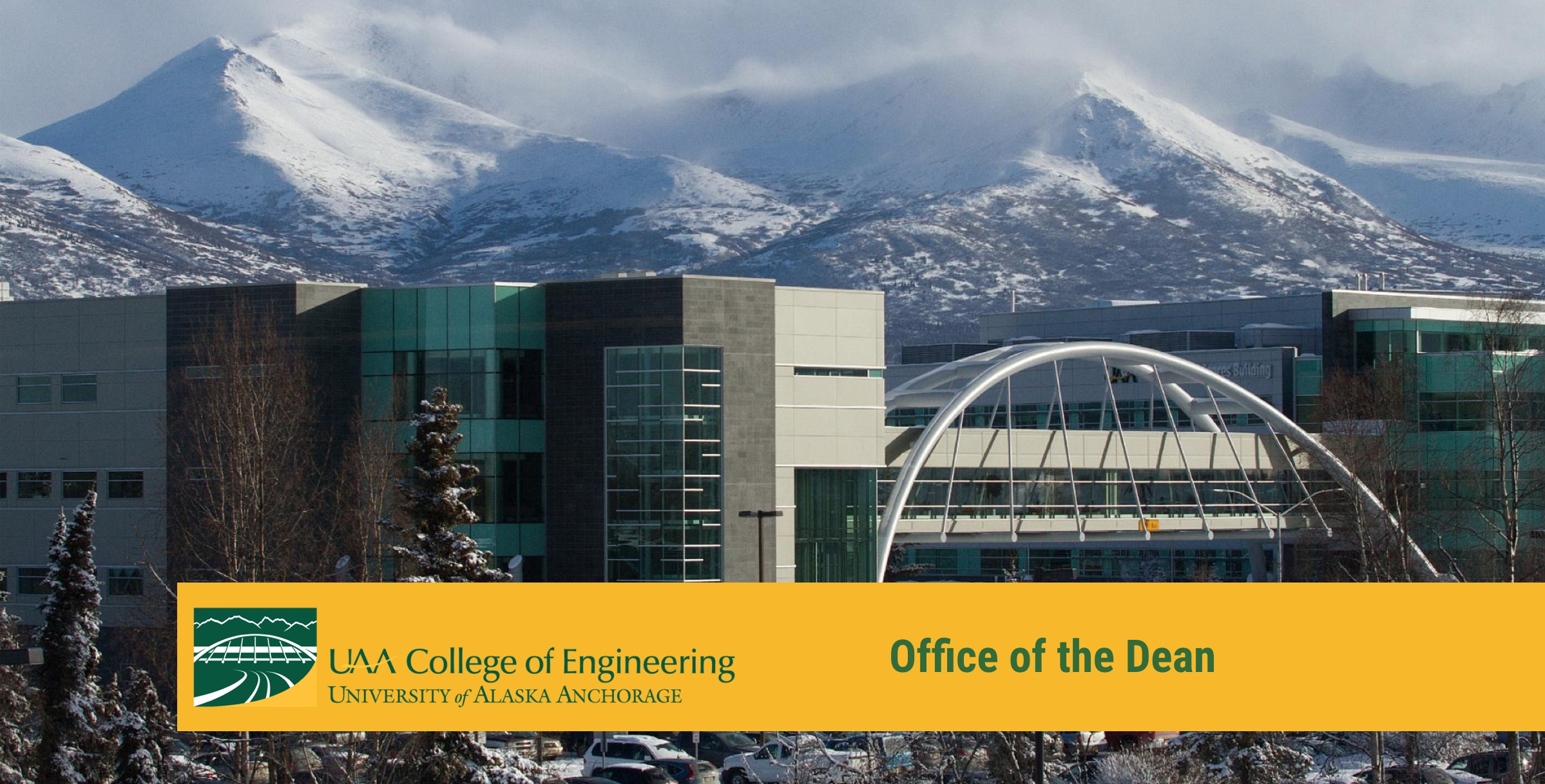 campus buildings with mountains in the background and header text for office of the dean