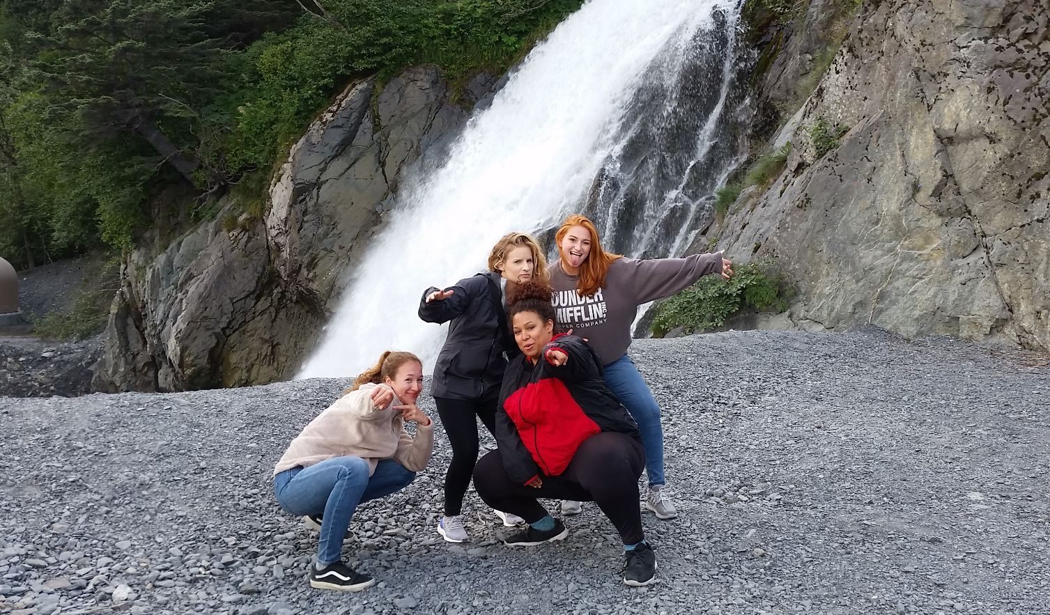 Girls pose in front of waterfall