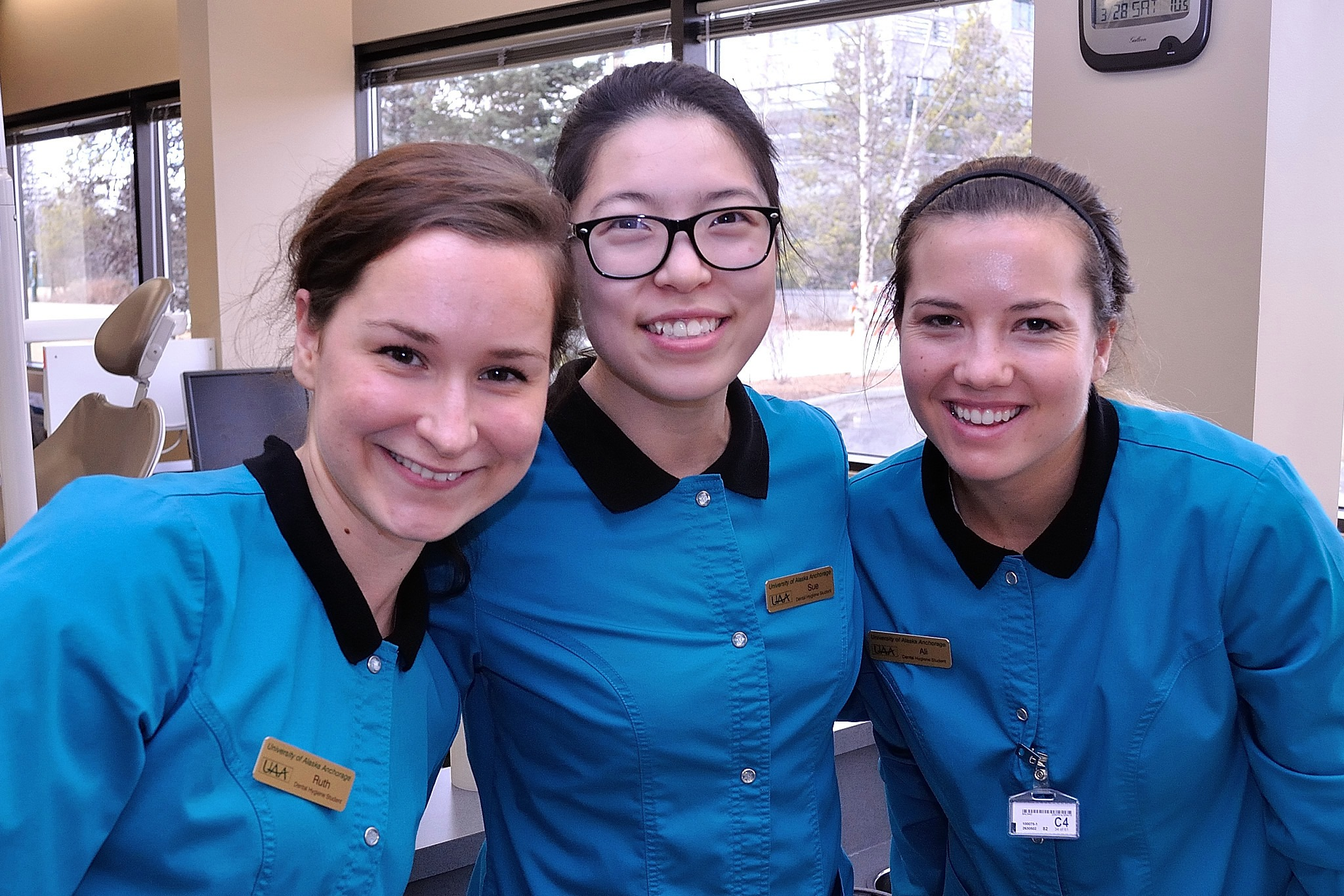 Dental Assistants smiling at camera