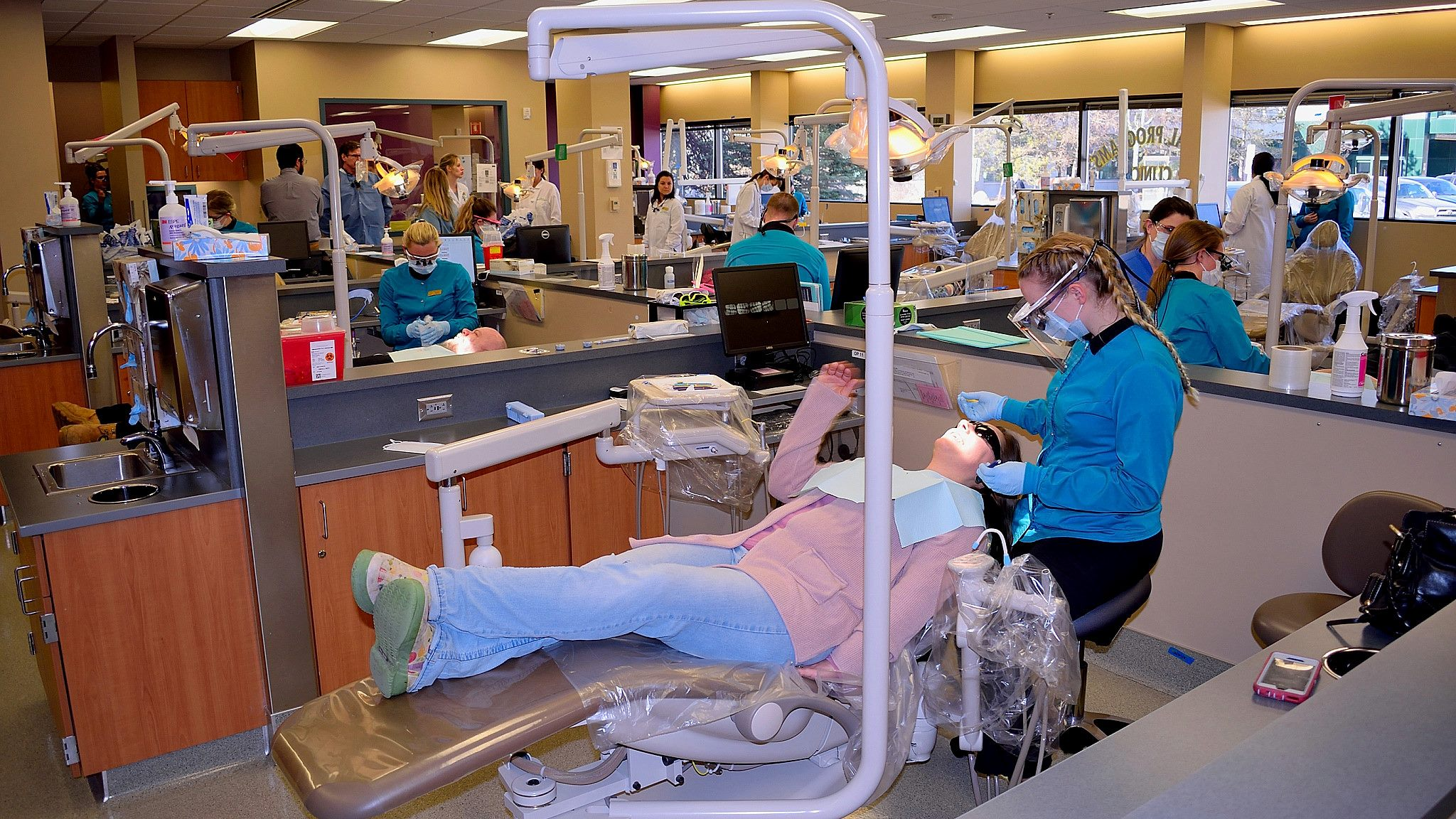 Dental students working on a patient