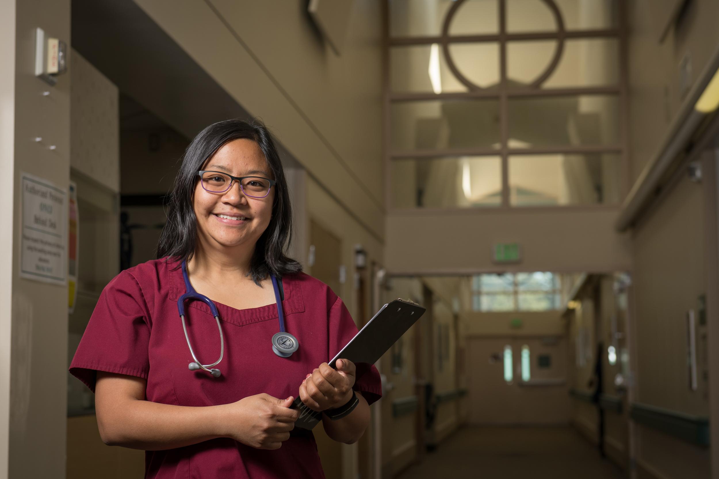 Nurse standing inhallway