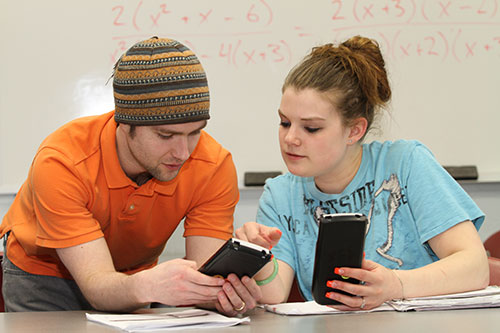 """Two student using calculators in Math Lab"""