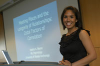 Psychology major Jessica Reyna presents her research at the 2006 Undergraduate Research & Discovery Symposium.