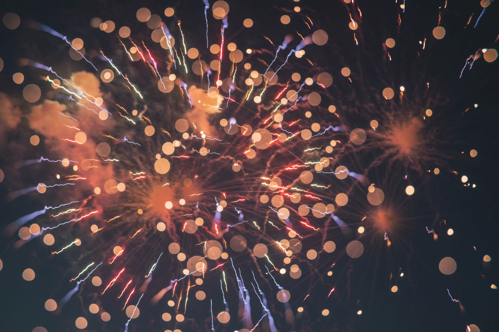 Close up view of a hand holding a sparkler.
