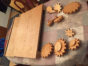 wooden gears stacked and stained