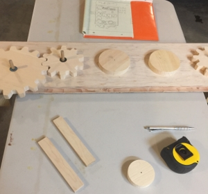 attaching gears to wooden board with pegs