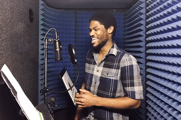 person in audio recording booth
