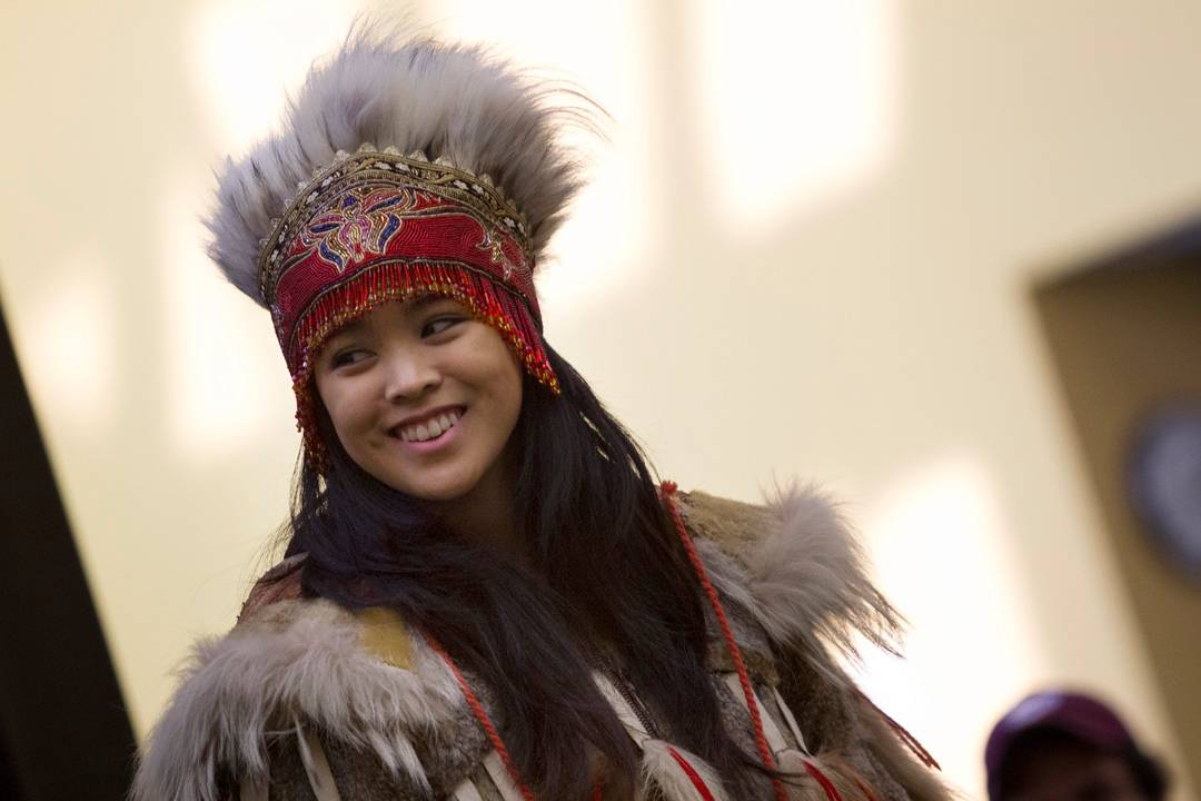 Native Alaskan dressed in traditional regalia