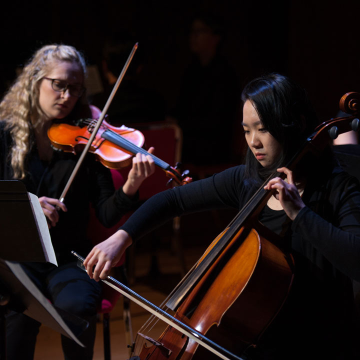 UAA cellist and violinist perform during Symphony of Sounds.
