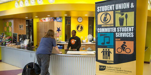A student at the Student Information Desk