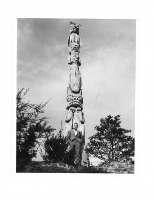 Actor John Barrymore stands by a totem pole he stole from Tuxecan while yachting along the Southeast Alaska coast in 1931. (Photo courtesy of Dr. Stephen Langdon)