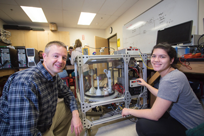 Hicks with alumnus Amanda Bowman, a B.S. Mechanical Engineering '17 grad who worked on many projects in the UAA Plasma Physics Laboratory. (Photo courtesy, Nathaniel Hicks)
