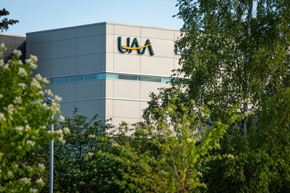 UAA's Engineering & Industry Building viewed through the trees (Photo by James Evans / UAA)