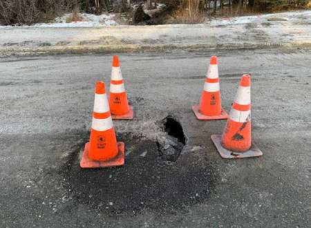 Sinkhole caused by collapsing culvert under Northern Lights Boulevard