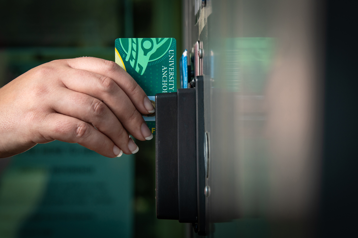 Swiping WOLFcard to access campus building