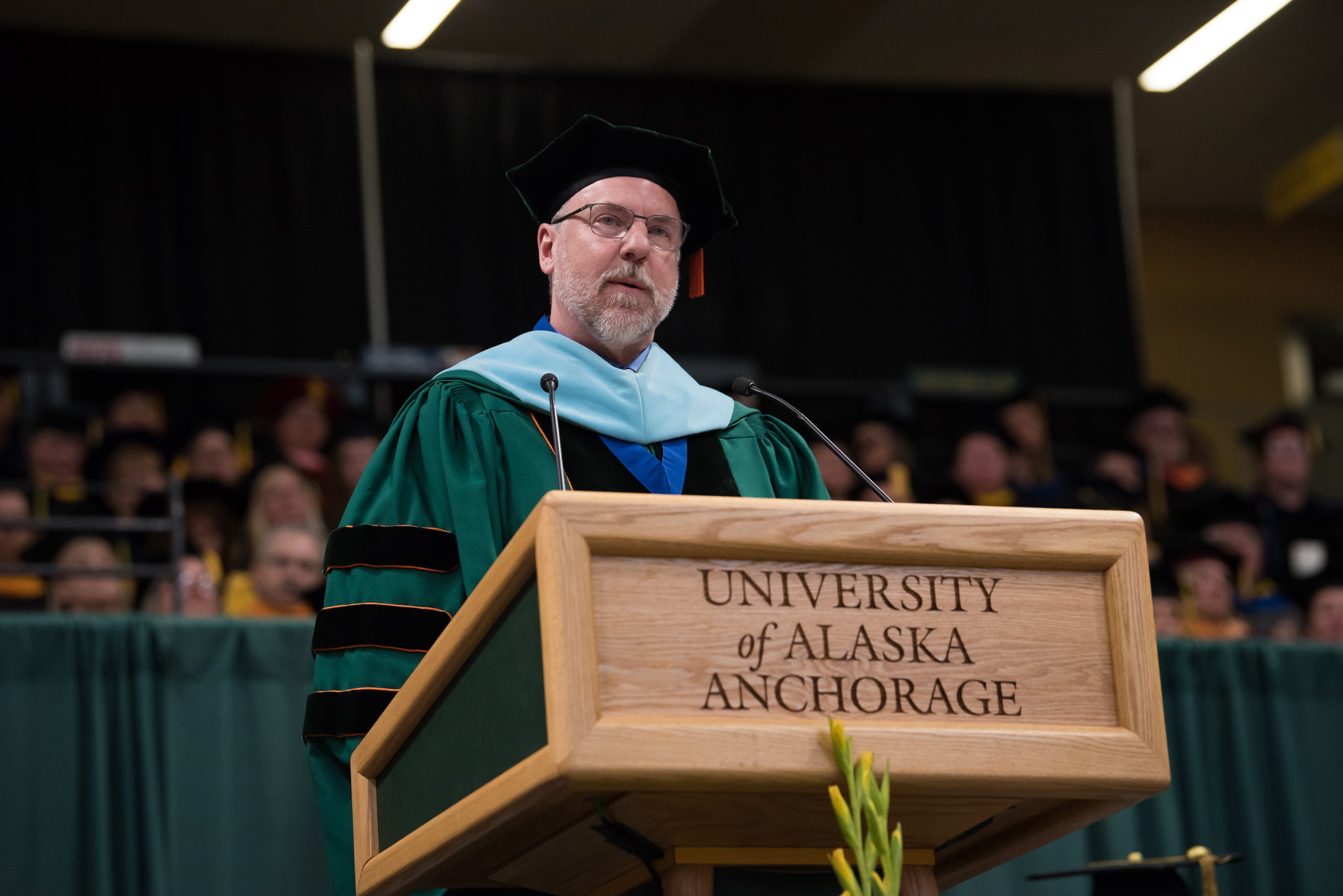 Vice Chancellor for Student Affairs Bruce Schultz, who will begin a new role as UAA's interim chancellor on Jan. 4, 2021, announces the commencement speaker during UAA's 2019 Spring Commencement at the Alaska Airlines Center.