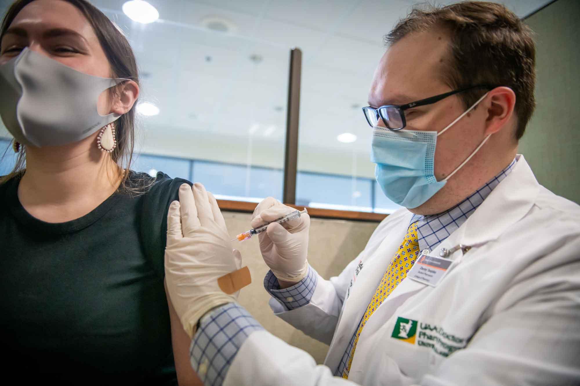 UAA pharmacy student administers COVID-19 vaccine
