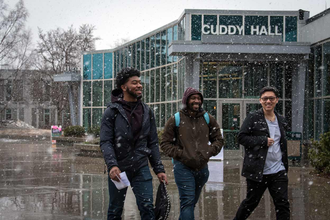 From left: Josiah Phillips, Tim Brown, and Hojung Jang cross Cuddy Quad during an April snowstorm on the UAA Campus.