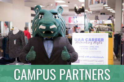 Spirit mascot dressed up and holding thumbs up at UAA Career Networking Night