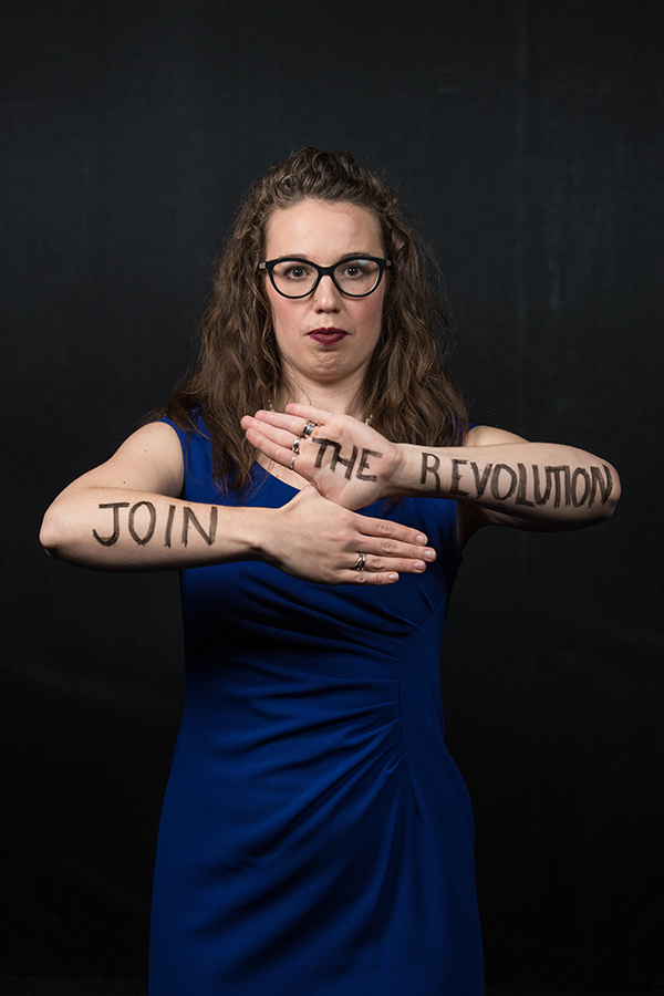join the revolution written on a person's arms