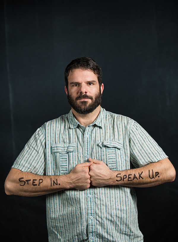 step in speak up written on man's arms