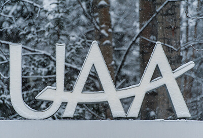 UAA sign in fresh snow.