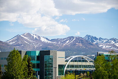 UAA Skybridge in foreground with Chugach Mountains behind.