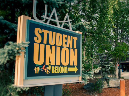 UAA Student Union sign points towards front door.