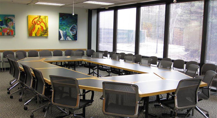 Lyla Richard Conference Room with tables and chairs setup in round table style