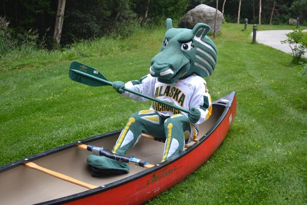 Spirit the Seawolf sitting in a rental canoe